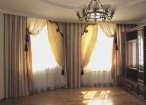 Шторы на эркерное окно (55 фото): занавески для эркера в гостиную и кухню, красивые модели гардин